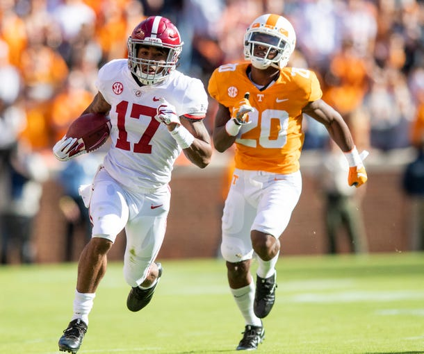 Alabama wide receiver Jaylen Waddle (17) pulls away from Tennessee defensive back Bryce Thompson (20) on a touchdown reception in first half action at Neyland Stadium in Knoxville, Tn., on Saturday October 20, 2018.