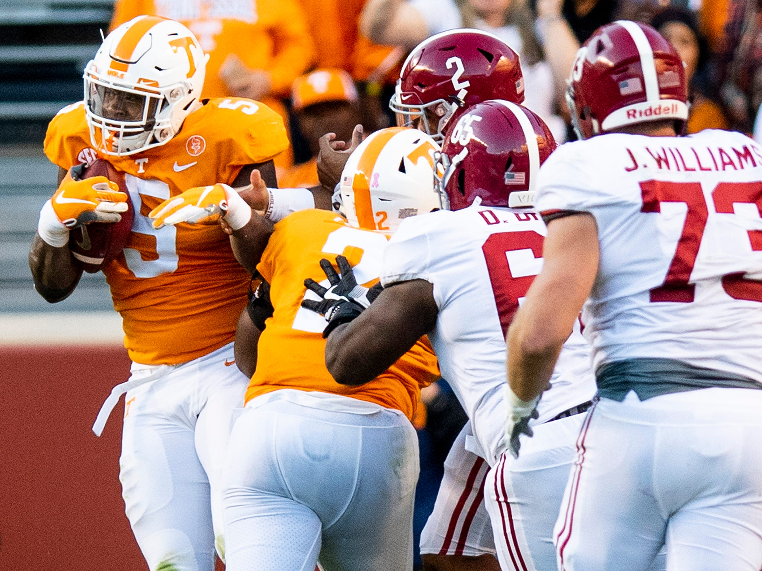 Tennessee defensive lineman Kyle Phillips (5)  inrtercepts a pass by Alabama quarterback Jalen Hurts (2) in second half action at Neyland Stadium in Knoxville, Tn., on Saturday October 20, 2018.