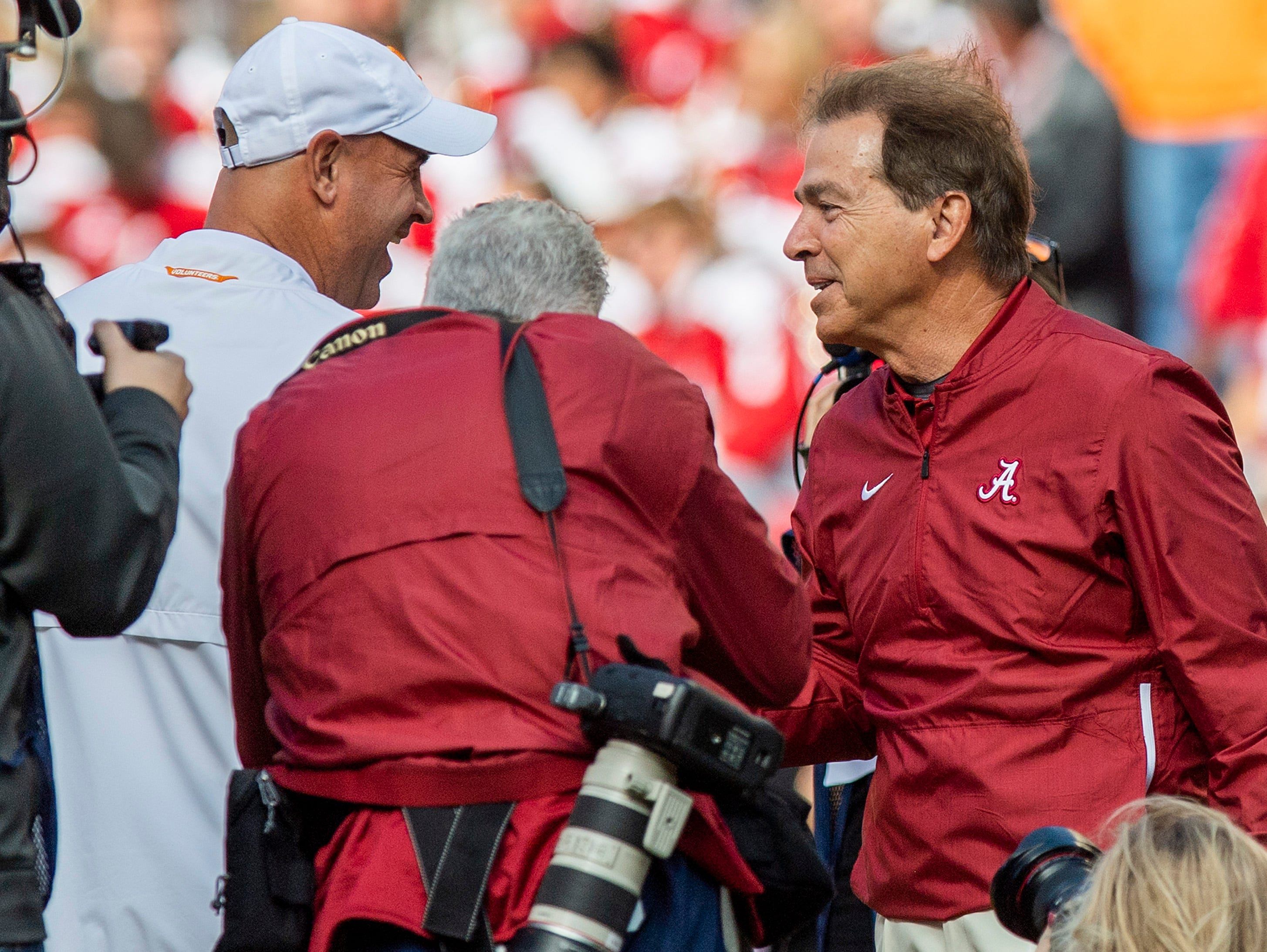 Tennessee head coach Jeremy Pruitt  and Alabama head coach Nick Saban meet at mid field before their game at Neyland Stadium in Knoxville, Tn., on Saturday October 20, 2018.