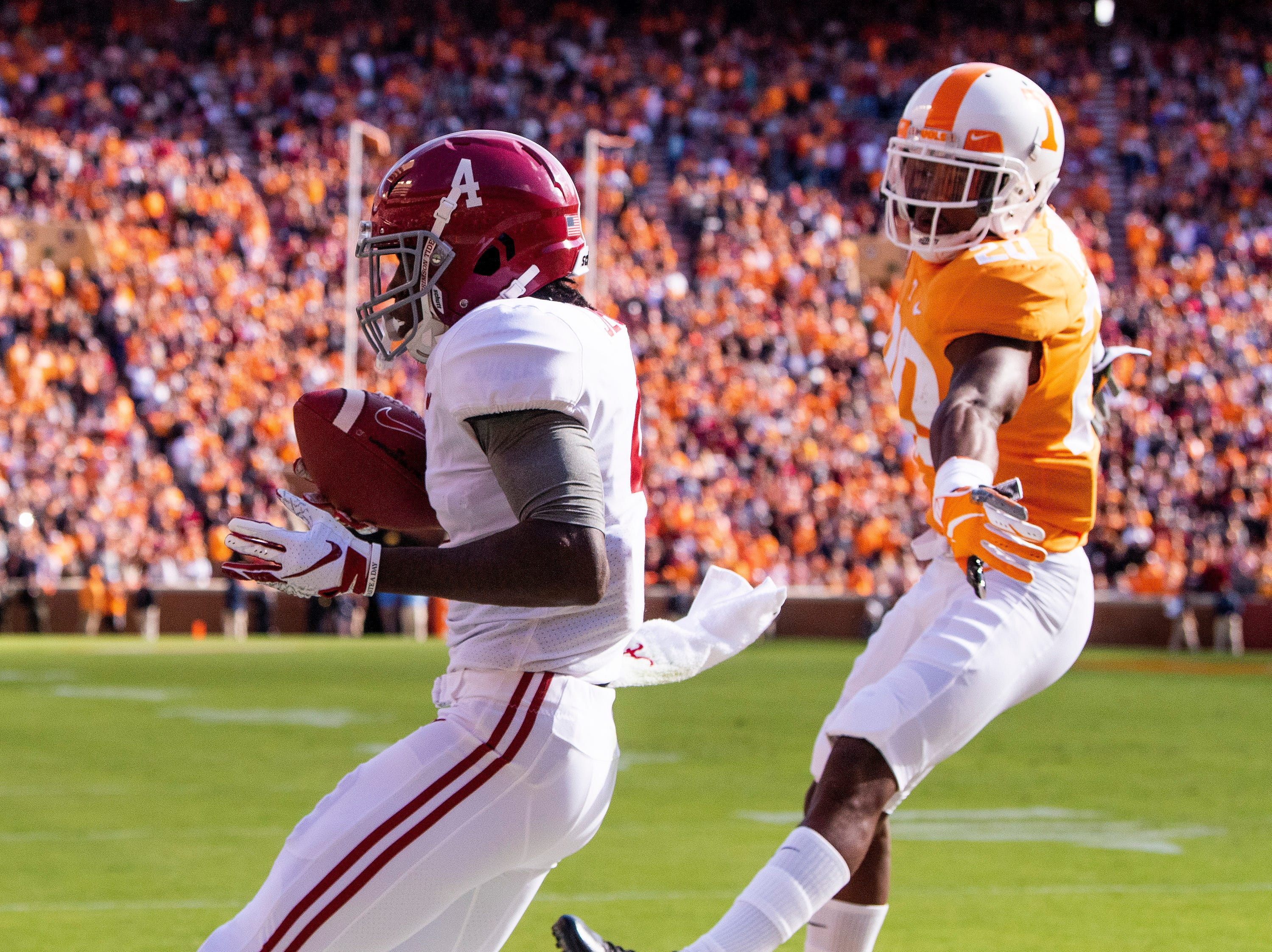 Alabama wide receiver Jerry Jeudy (4) catches a touchdown pass against Tennessee defensive back Bryce Thompson (20) in first half action at Neyland Stadium in Knoxville, Tn., on Saturday October 20, 2018.