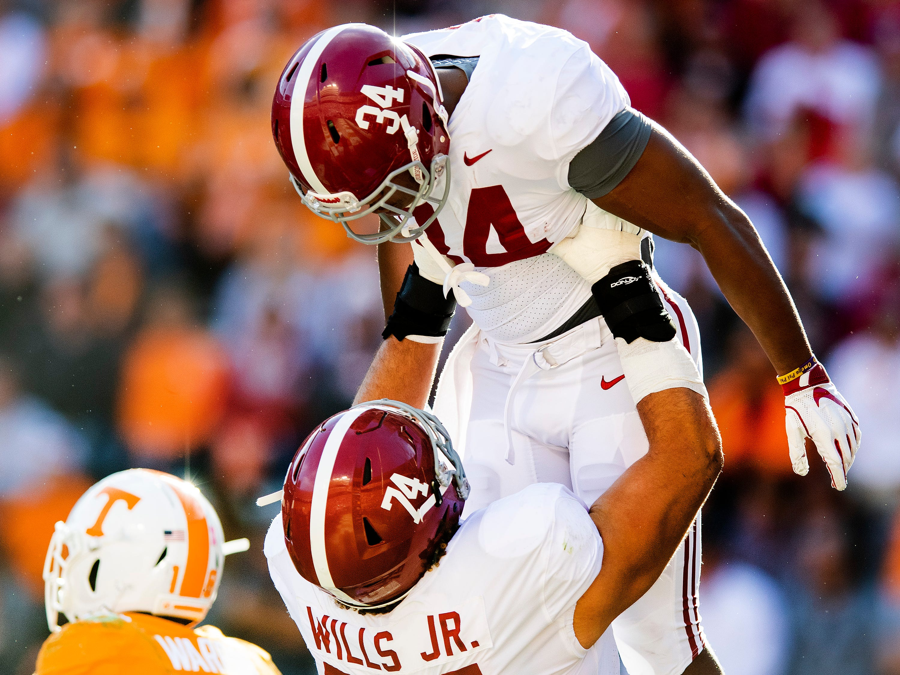 Alabama running back Damien Harris (34) is lifted by offensive lineman Jedrick Wills, Jr., (74) after scoring a touchdown in first half action at Neyland Stadium in Knoxville, Tn., on Saturday October 20, 2018.