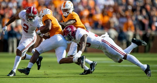 Alabama defensive back Patrick Surtain, II, (2) and Alabama linebacker Mack Wilson (30) stop Tennessee running back Ty Chandler (8) in first half action at Neyland Stadium in Knoxville, Tn., on Saturday October 20, 2018.