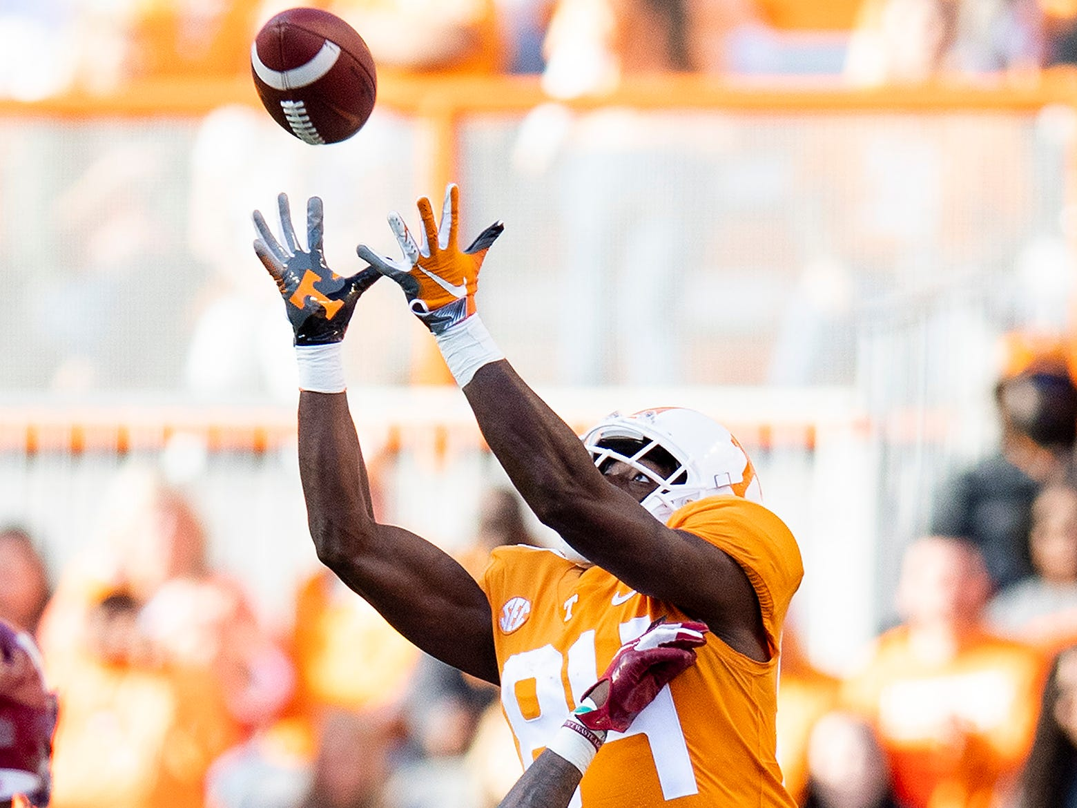 Tennessee receiver Josh Palmer (84) catches a pass over Alabama defensive back Saivion Smith (4) in first half action at Neyland Stadium in Knoxville, Tn., on Saturday October 20, 2018.