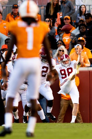 Alabama punter Mike Bernier (98) punts against Tennessee in first half action at Neyland Stadium in Knoxville, Tn., on Saturday October 20, 2018.