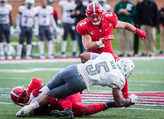 Ball State's Jacob White (2) comes in to assist on a tackle against Eastern Michigan during their game at Scheumann Stadium Saturday, Oct. 20, 2018.