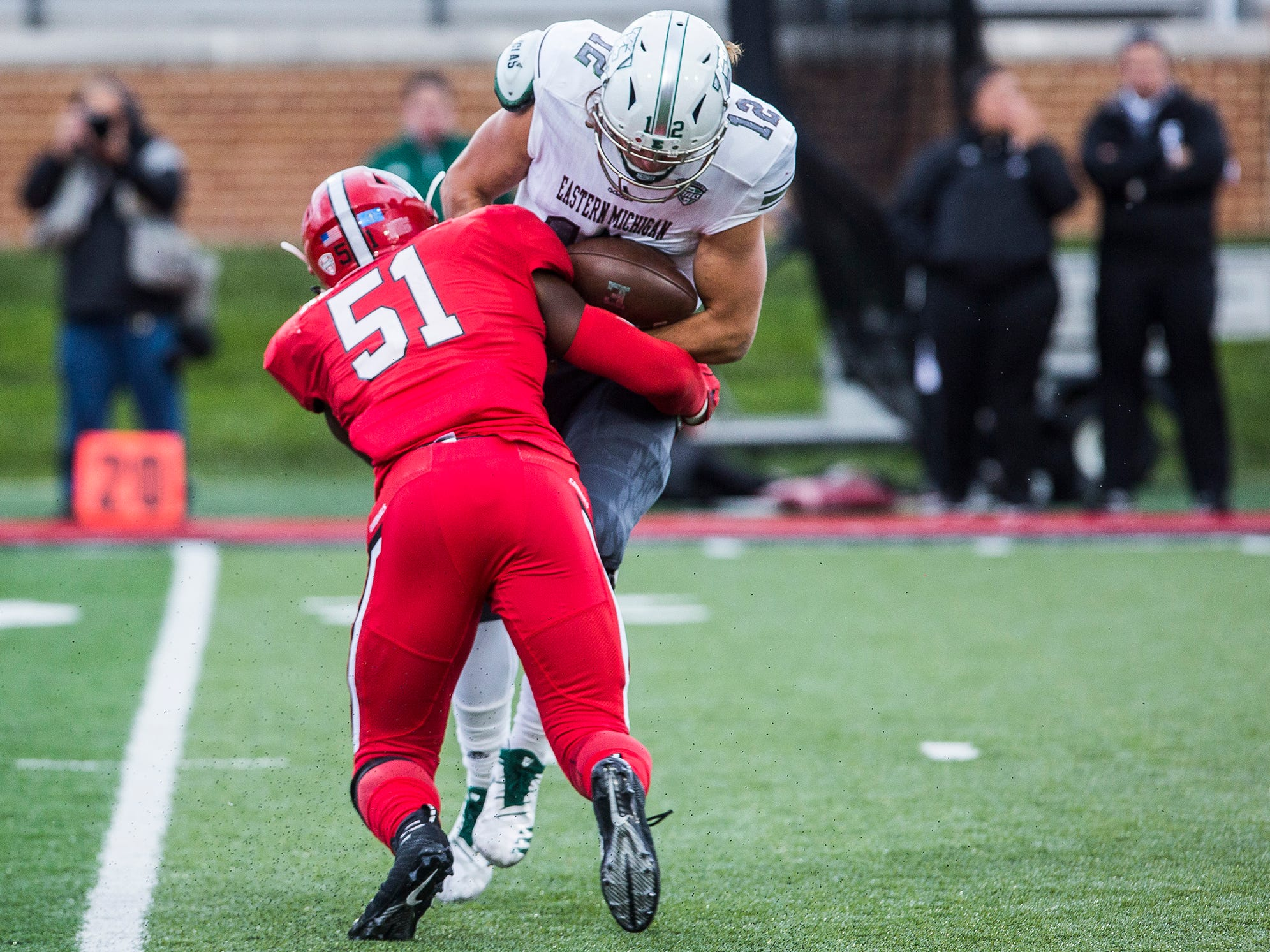 Ball State's Christian Albright sacks Eastern Michigan quarterback Tyler Wiegers during their game at Scheumann Stadium Saturday, Oct. 20, 2018.