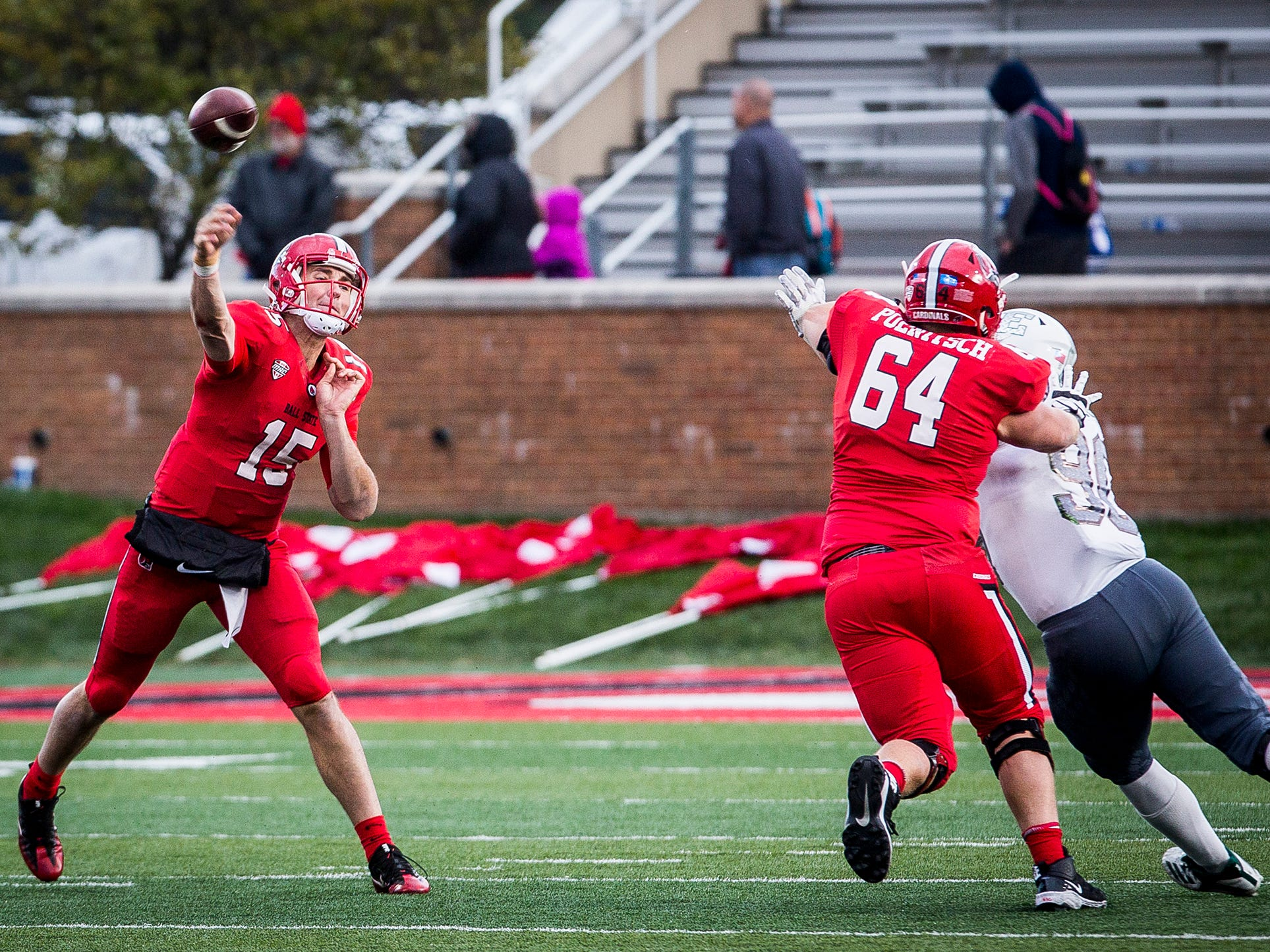 Ball State's Andrew Poenitsch (64) holds his block as Riley Neal throws a pass against Eastern Michigan during their game at Scheumann Stadium Saturday, Oct. 20, 2018.