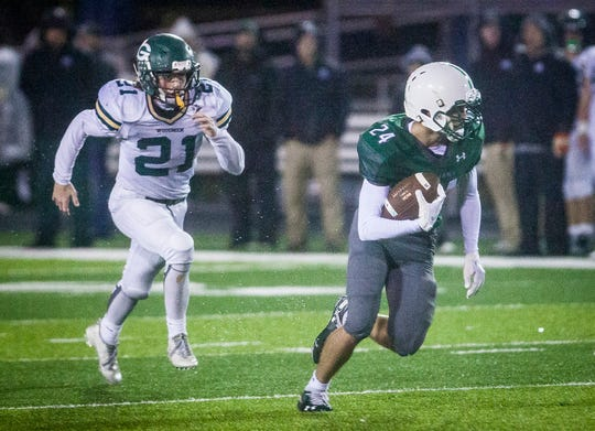 FILE -- Former New Castle football player Nicholas Grieser breaks away from Greenwood's defense during their game at New Castle High School Friday, Oct. 19, 2018.