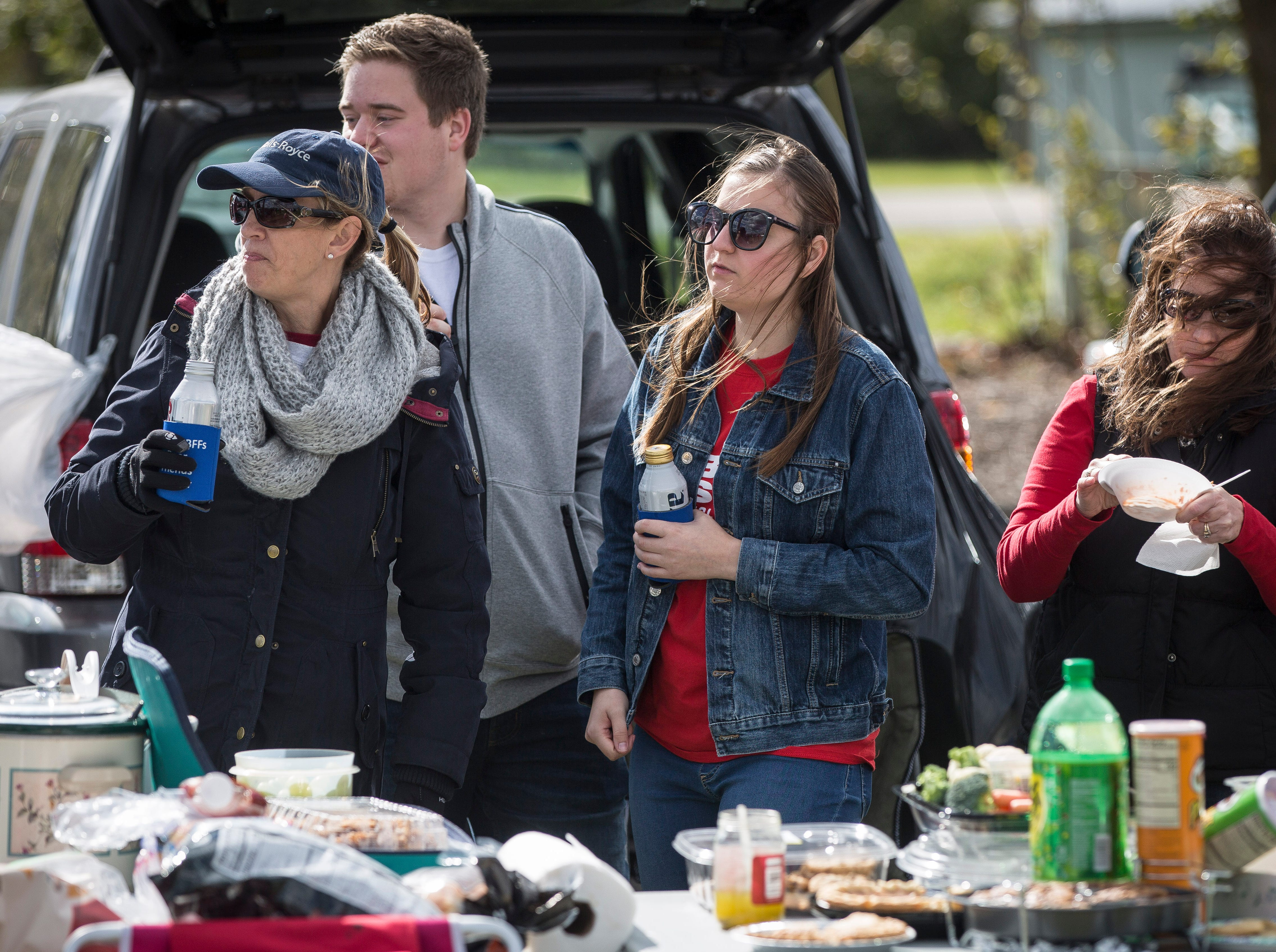Students and alumni take to the tailgate lots of Sheumann Stadium Saturday afternoon for homecoming tailgating. The annual homecoming week features dozens of events to celebrate the event.