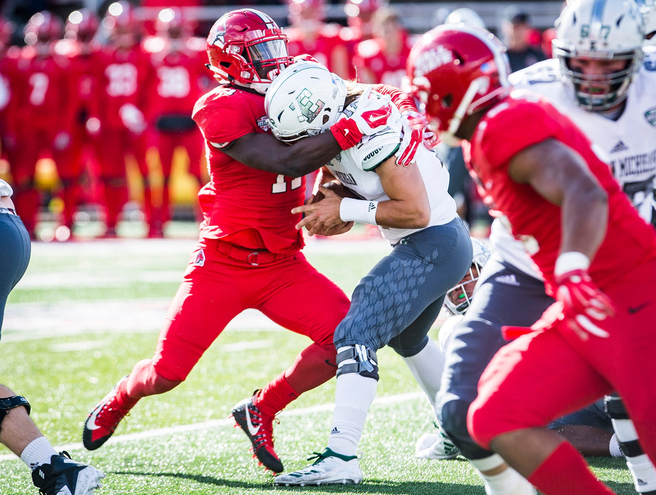Ball State's Corey Lacanaria sacks Eastern Michigan's Tyler Wiegers during their game at Scheumann Stadium Saturday, Oct. 20, 2018.