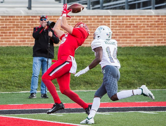 Ball State's Riley Miller catches a touchdown pass from Riley Neal against Eastern Michigan's defense during their game at Scheumann Stadium Saturday, Oct. 20, 2018.