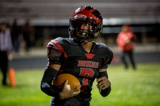 FILE -- Blackford's Isaac Justice runs the ball during a sectional victory over Northwestern on Oct. 19, 2018. Justice's 200 yards of total offense in the Bruins' win over Madison-Grant Friday earned earned him The Star Press Football Player of the Week honors.