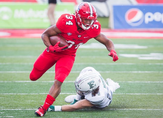 Ball State's James Gilbert breaks away from Eastern Michigan's defense during their game at Scheumann Stadium Saturday, Oct. 20, 2018.
