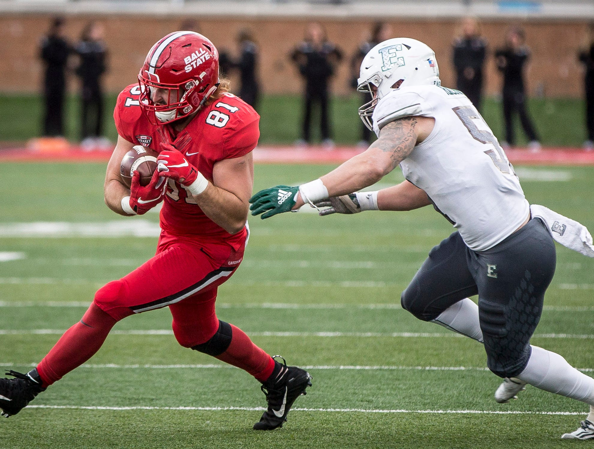 Ball State's Kyle Schrank attempts to make it past the defense during Saturday's game at Scheumann Stadium. Eastern Michigan won with a final score of 42-20.