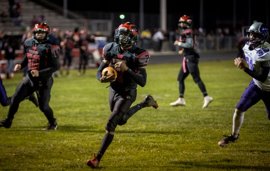 Blackford's Isaac Justice scores a touchdown Friday night at Blackford High School during the first round of the IHSAA 3A Sectional 26.  Blackford won the game against Northwestern 51-0.