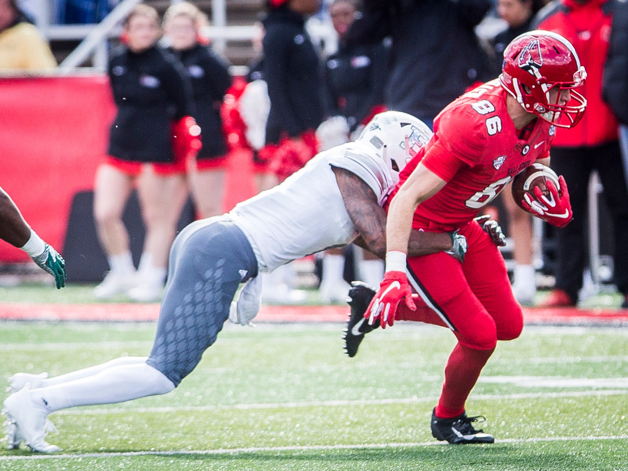 Ball State's Riley Miller fights for more yardage against Eastern Michigan during their game at Scheumann Stadium Saturday, Oct. 20, 2018.