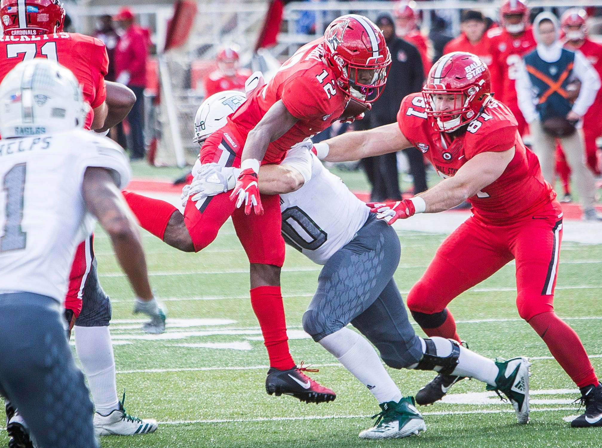Ball State's Justin Hall struggles against Eastern Michigan's defense during their game at Scheumann Stadium Saturday, Oct. 20, 2018.