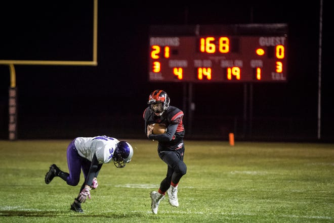 Blackford's Shane Elam runs past a tackler during a sectional victory over Northwestern on Oct. 19, 2018.