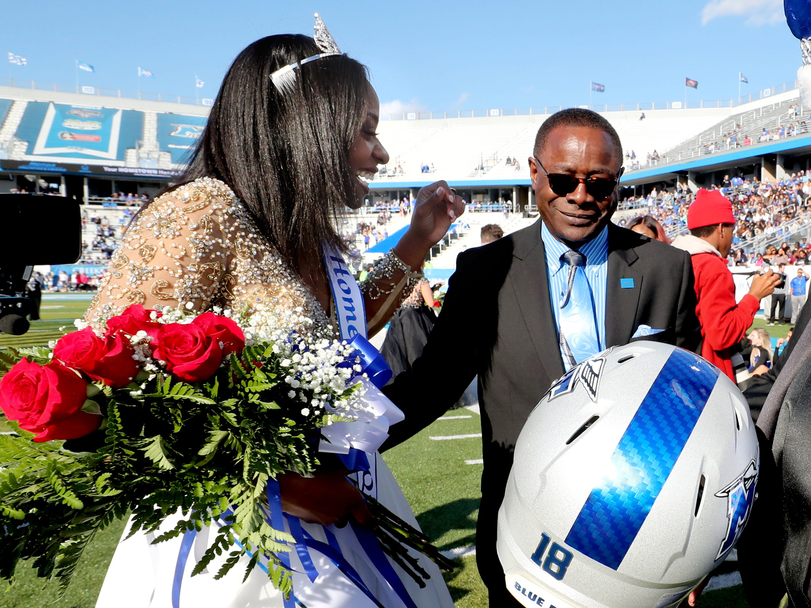 MTSU's Homecoming Queen Georgette Redmond reacts after being name MTSU's new Homecoming Queen with MTSU President Sidney McPhee gets during halftime of the game the Homecoming game against Charlotte, on Saturday, Oct. 20, 2018.