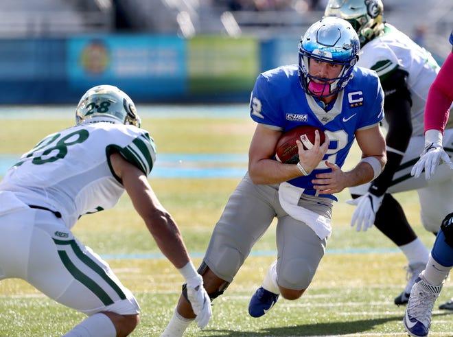 MTSU's quarterback Brent Stockstill (12) runs the ball against Charlotte on Saturday, Oct. 20, 2018.