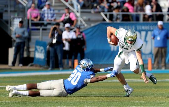 Charlotte's quarterback Evan Shirreffs (16) runs the ball as MTSU's DQ Thomas (20) tries to stop him on Saturday, Oct. 20, 2018.