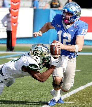 MTSU's quarterback Brent Stockstill (12) is sacked by Charlotte's Ed Rolle (2) on Saturday, Oct. 20, 2018.