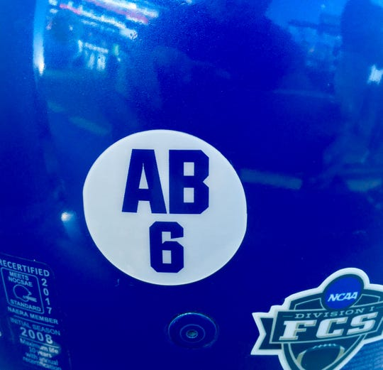 Tennessee State's players wore decals as a tribute to injured Tiger Christion Abercrombie on their new blue helmets for Saturday's homecoming game against Tennessee Tech.