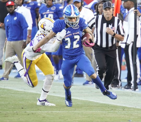 Tennessee State's Earl Harrison tries to break free on a run during Saturday's game against Tennessee Tech.