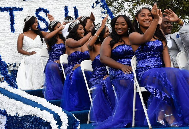 The 2018 TSU Homecoming court waves to the crowd during the homecoming parade along John Merritt Blvd. on Tennessee State University campus Saturday, Oct. 20, 2018, in Nashville, Tenn.