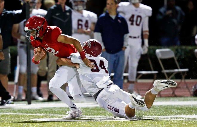 Brentwood Academy's Wade Williams (12) is tackled by Montgomery Bell's Jackson Hannah during their game Friday, Oct. 19, 2018, in Nashville, Tenn.