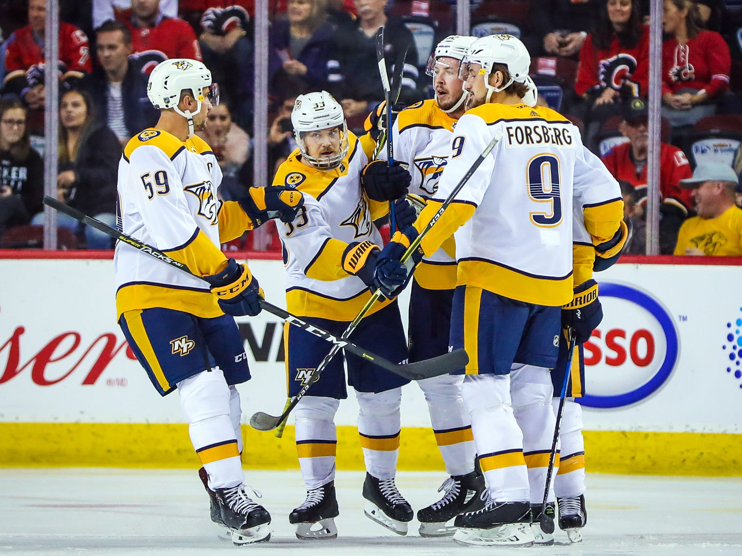 Oct 19: Predators 5, Flames 3 -- Nashville Predators center Ryan Johansen (92) celebrates his goal with teammates against the Calgary Flames during the first period at Scotiabank Saddledome.