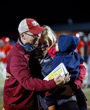 Montgomery Bell head coach Marty Euvarard celebrates their overtime win against Brentwood Academy with his daughter Megan and his grandson. Friday, Oct. 19, 2018, in Nashville, Tenn.