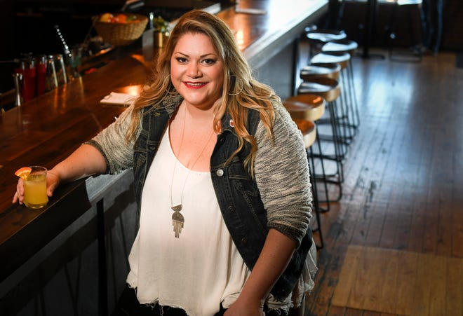 Katie MacLachlan hasn't missed the frenetic pace and high cost of New York City living since moving to Nashville three years ago.  She traded a 400-square-foot apartment for her own home, and partnered with a friend to open Walden bar and restaurant in East Nashville.  Saturday, Oct. 20, 2018, in Nashville, Tenn.