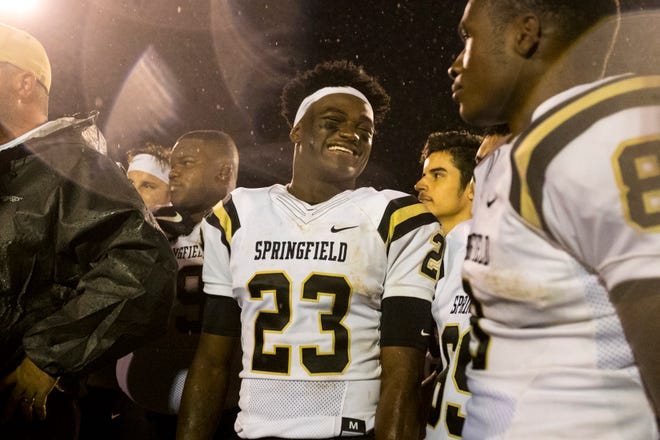 Springfield's Dayron Johnson (23) smiles as trophies are presented to Springfield after Greenbrier's game against Springfield at Greenbrier High School in Greenbriar on Friday, Oct. 19, 2018.