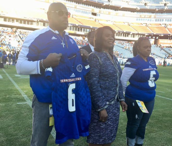 The uncle Kevin Richardson and aunt Shawn Neason of injured Tennessee State football player Christion Abercrombie took part in the coin toss for Saturday's game against Tennessee Tech at Nissan Stadium. TSU President Glenda Glover accompanied them.