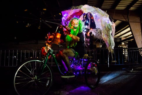 """Michelle Waisanen, of Naples, poses for a portrait on her decorated bike during the Haunted """"Gross"""" House at the Collier County Fairgrounds in Naples on Friday, Oct. 19, 2018."""