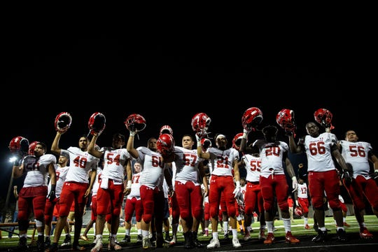 The Immokalee High School football team celebrates their win over Lely High School on Friday, October 19, 2018, at Lely High School in Naples.