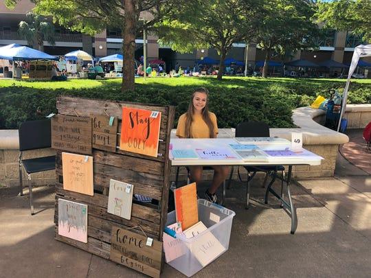Skylar Alcantara, 15, sold her paintings at the Naples Children's Business Fair on Oct. 20, 2018.