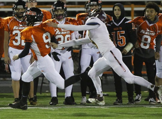 Rocco Minichello of Hasbrouck Heights takes the opening kickoff from Park Ridge for a touchdown Friday, Oct. 19, 2018 in an NJIC semifinal at Hasbrouck Heights.