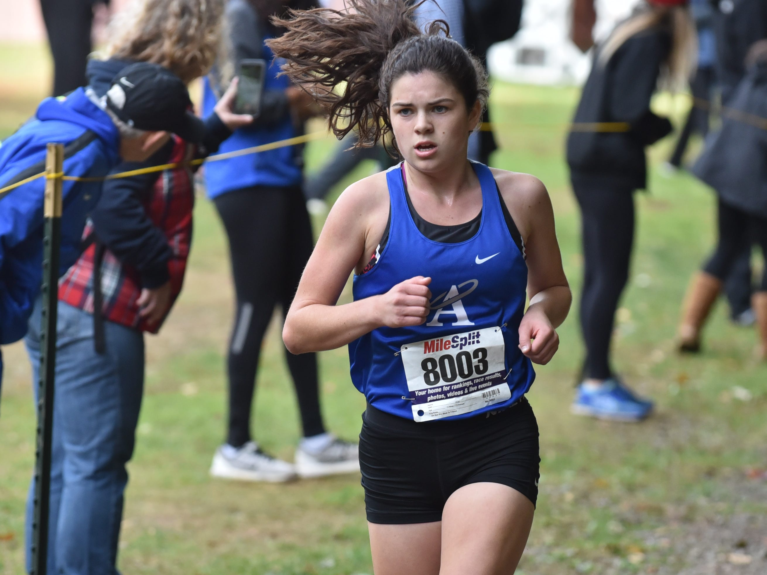 Christina Bagin of Holly Angels wins 3rd in Group E at the Bergen County Cross Country Championships.
