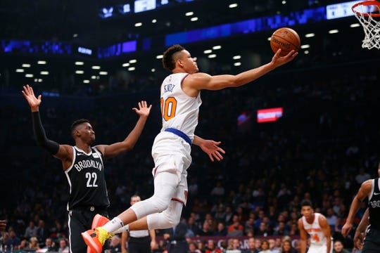 Oct 19, 2018; Brooklyn, NY, USA; New York Knicks forward Kevin Knox (20) drives to the basket against Brooklyn Nets guard Caris LeVert (22) during the first half at Barclays Center.