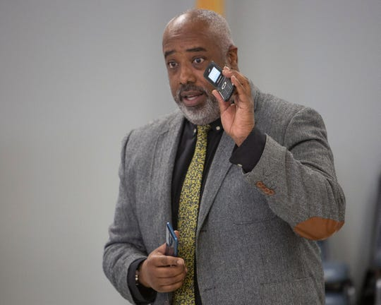 Kevin Tillman, a rescue operative in the child exploitation and human trafficking unit for Immigrations and Custom Enforcement (ICE )Homeland Security Investigations (HSI) holds up a cell phone demonstrating the tools predators use, during the human trafficking awareness event  at the Borough of Totowa Community Center on Saturday, October 20 2018. Grace Rose, A girl scout, organized the event as part of her Gold Award project.