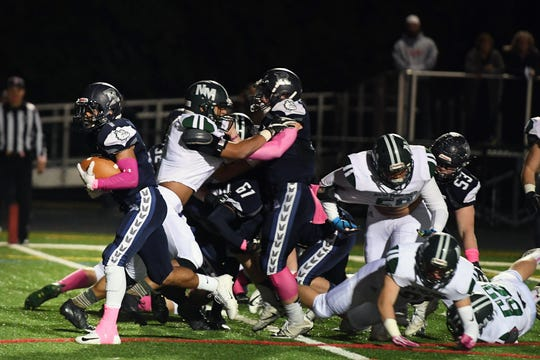 New Milford at Rutherford in North Jersey Interscholastic Conference playoff semifinal on Friday, October 19, 2018. (left) R #1 Abellany Mendez scores a touchdown in the second quarter.