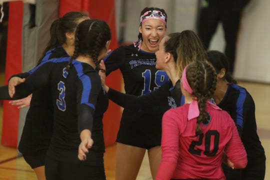 Isabella Heyaime of Passaic celebrates a point by her team in the first set.