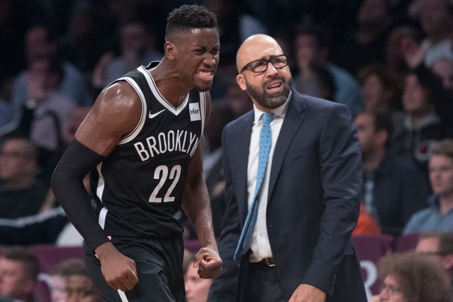 Brooklyn Nets guard Caris LeVert (22) and New York Knicks head coach David Fizdale react in the final minutes of the second half of an NBA basketball game, Friday, Oct. 19, 2018, in New York.