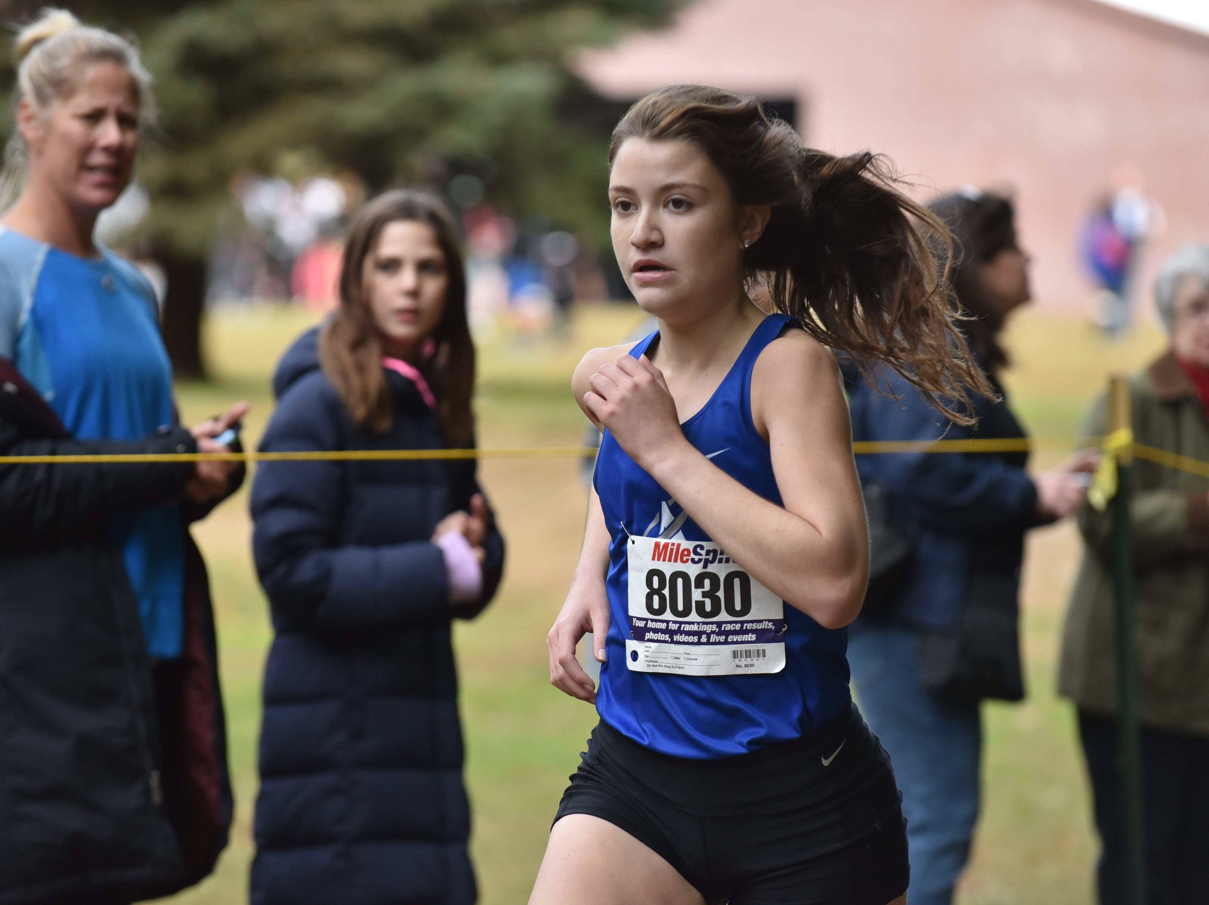 Olivia Mandela of Holly Angels wins 1st in Group E at the Bergen County Cross Country Championships.