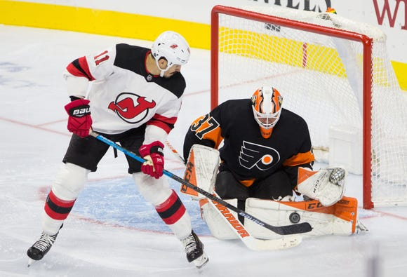 Oct 20, 2018; Philadelphia, PA, USA; Philadelphia Flyers goaltender Brian Elliott (37) makes a save on New Jersey Devils center Brian Boyle (11) during the third period at Wells Fargo Center.