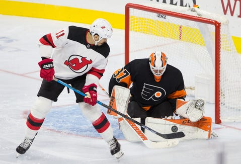Oct 20, 2018; Philadelphia, PA, USA; Philadelphia Flyers goaltender Brian Elliott (37) makes a save on New Jersey Devils center Brian Boyle (11) during the third period at Wells Fargo Center.