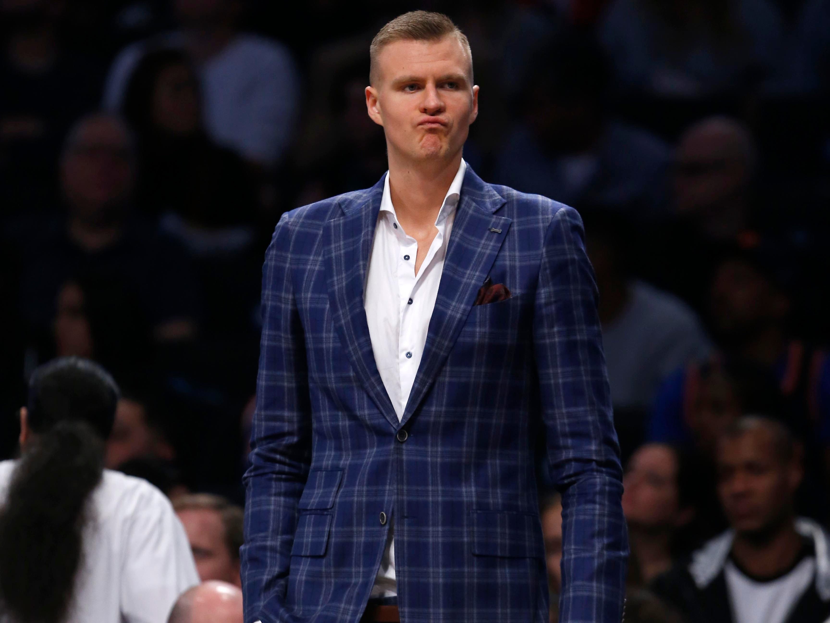 Oct 19, 2018; Brooklyn, NY, USA; New York Knicks forward Kristaps Porzingis looks on  during a second half time out against the Brooklyn Nets at Barclays Center.