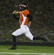 Rocco Minichello of Hasbrouck Heights takes the opening kickoff for a TD Friday, Oct. 19, 2018 in an NJIC semifinal at Hasbrouck Heights.